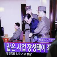 Fall from grace: A TV monitor in Seoul displays Jang Song Thaek's court appearance on Friday. | AFP-JIJI