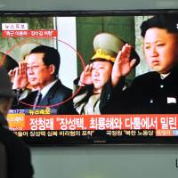 Canceled: A man watches a TV showing news of the alleged dismissal of Jang Song Thaek, North Korean leader Kim Jong Un's uncle, in Seoul on Tuesday. | AFP-JIJI