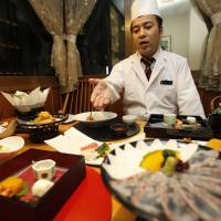 'Washoku' reigns supreme: Kenji Uda, the head chef at Irimoya Bettei restaurant in Tokyo, serves up some fancy fare Nov. 27. | AP