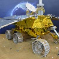 Come over, come over: A model of the Yutu lunar rover is displayed at the China International Industry Fair 2013 in Shanghai on Nov. 5.  | AFP-JIJI