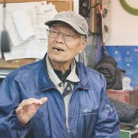 Nowhere to hide: 'I'm worried about a big earthquake striking below Tokyo. I think about it,' says Yasuharu Oki, 78. 'This area is the same height as sea level. If there's a tsunami, it'll be full of water here.' | CAMERON ALLAN MCKEAN
