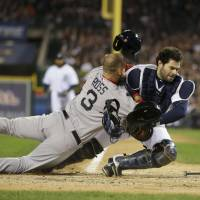 High impact: Boston's David Ross collides with Detroit catcher Alex Avila during Game 5 of the American League Championship Series in October.   AP