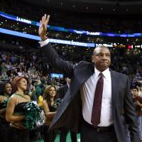 Good to see you: Los Angeles head coach Doc Rivers waves to fans at Boston's TD Garden before the Clippers' 96-88 win over the Celtics on Wednesday.   AP