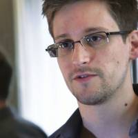 Spy games: Former U.S. National Security Agency contractor Edward Snowden gives an interview to Britain's The Guardian newspaper in Hong Kong on June 6. | AFP-JIJI