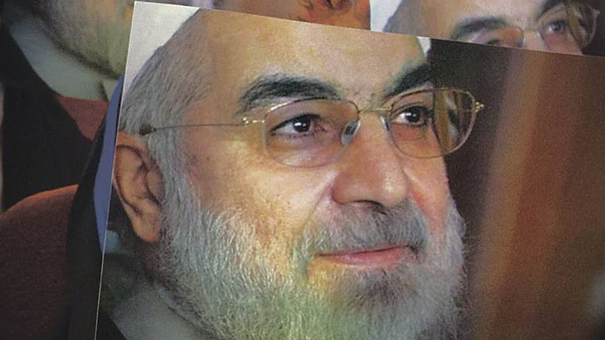 Face of change?: Women hold up posters of Iranian presidential candidate Hassan Rouhani during a campaign rally in Tehran on May 30. Rouhani cruised to victory in the June election. | AP