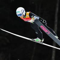 Jump for joy: Sara Takanashi is among the favorites to win gold when women's ski jumping makes its Olympic debut during the Sochi Games. | AP