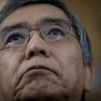 Monetize me: Bank of Japan Gov. Haruhiko Kuroda speaks in New York on Oct. 10. Kuroda said his bond-guzzling BOJ will do what it needs to beat deflation but declined to specify any extra steps it might take. | BLOOMBERG