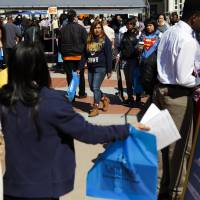 Getting ready for real life: Students attend a hiring event in Los Angeles. Some parents have become over-involved in their kids' problems, even after they've left home — a trend that Carolyn O'Laughlin, director of residence life at Sarah Lawrence College, New York, says could leave kids unprepared for the future. | BLOOMBERG