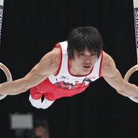 Lord of the rings: Kohei Uchimura performs on the rings during the all-around final at the world gymnastics championships in Antwerp, Belgium, in October.  | AP
