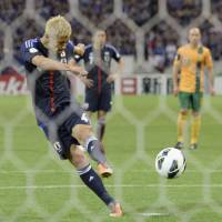 First past the post: Keisuke Honda  scores a penalty in injury time at Saitama Stadium in June to give Japan a 1-1 draw with Australia, making the Blue Samurai the first team to qualify for the 2014 World Cup.  | KYODO