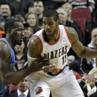 Surprise, surprise: Portland's LaMarcus Aldridge backs in on Oklahoma City's Kendrick Perkins during the Blazers' 111-104 win. | AP