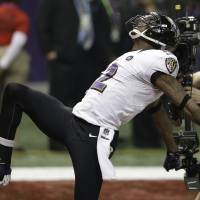 The Baltimore Ravens' Jacoby Jones celebrates after his 108-yard kickoff return to start the second half of Super Bowl XLVII.  The Ravens limped into the playoffs, but put things together in time to win the title. | AP