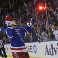 Are you impressed?: The Rangers' Carl Hagelin (left) celebrates after scoring against the Wild during the second period on Sunday in New York. The Rangers won 4-1.   AP