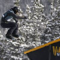Easy does it: Shaun White slides off a rail during the U.S. Grand Prix slopestyle snowboarding finals on Sunday in Copper Mountain, Colorado. White finished third.   AP