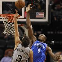 Make them work for it: Thunder center Serge Ibaka defends against the Spurs' Marco Belinelli on Saturday. | AP