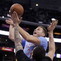 L.A. Confidential: Clippers forward Blake Griffin goes up for a shot against the Timberwolves' Nikola Pekovic. | AP