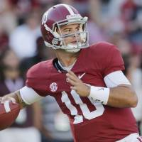 High honor: Alabama QB A.J. McCarron is the winner of the 2013 Maxwell Award, given annually to college football's player of the year. He is also a finalist for the Heisman Trophy. | AP