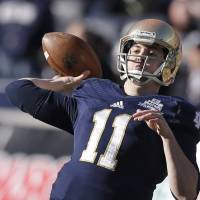 Going deep: Notre Dame QB Tommy Rees throws a pass against Rutgers in the Pinstripe Bowl on Saturday at Yankee Stadium. The Fighting Irish won 29-16. | AP