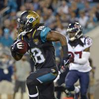 Ace in the hole: Jaguars receiver Ace Sanders runs away from a Texans defender on Thursday in Jacksonville. The Jaguars beat Houston 27-20 to earn a rare home win. | AP