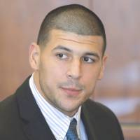 Troubles mount: Former New England Patriots tight end Aaron Hernandez has had a wrongful death suit filed against him by the family of Odin Lloyd, the man Hernandez is accused of murdering in June. | AP