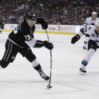 Full force: Los Angeles' Tyler Toffoli scores past San Jose's Dan Boyle in the second period on Thursday. The Kings won 4-1. | AP