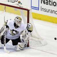 No room at the inn: The Penguins' Jeff Zatkoff saves a shot by the Blue Jackets' Mark Letestu on Sunday.   AP