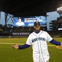 Great expectations: Second baseman Robinson Cano shows off his new uniform after being introduced by the Seattle Mariners at a news conference at Safeco Field on Thursday. | AP
