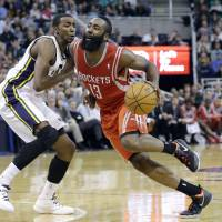 Surprising score: Houston's James Harden drives on Utah's Jeremy Evans in the second half on Monday night. The Jazz downed the Rockets 109-103. | AP
