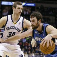 All you need is love: Timberwolves forward Kevin Love attempts to drive around the Grizzlies' Jon Leuer on Sunday in Memphis. Minnesota won 101-93. | AP