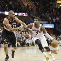 Right down Broadway: Cleveland's Kyrie Irving drives the lane against Portland's Nicolas Batum in the fourth quarter on Tuesday. | AP
