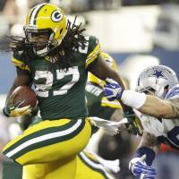 Ahead of the pack: Packers running back Eddie Lacy gets away from Cowboys defensive tackle Nick Hayden during the first half of their game on Sunday in Dallas. The Packers rallied from a 23-point deficit to earn a 37-36 win. | AP