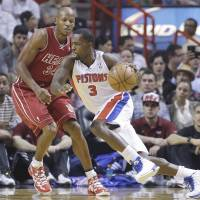 Pump it up: Detroit's Rodney Stuckey (3) drives to the basket as Miami's Ray Allen defends during the Pistons' 107-97 win on Tuesday. | AP