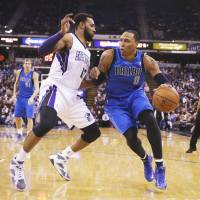 Doing it on both ends: Sacramento's Derrick Williams defends against Dallas' Shawn Marion in the first half on Monday night. The Kings downed the Mavericks 112-97.   AP