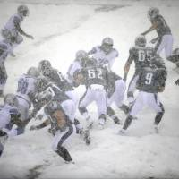 Walking in a winter wonderland: The Eagles and Lions played through snowy conditions on Sunday in Philadelphia. The Eagles got the best of the matchup, winning 34-20. | AP