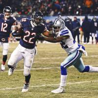 Going in: Chicago's Matt Forte fends off Dallas' Orlando Scandrick on a 4-yard TD reception in the second half on Monday night. | AP