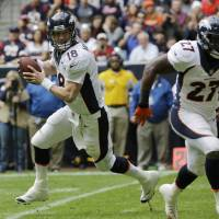 Prolific passer: Denver Broncos QB Peyton Manning broke the NFL record for single-season TD passes with his 51st in a win over Houston on Sunday. | AP
