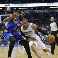 Speed against strength: Arizona's Arron Afflalo drives around New York's Amare Stoudemire on Monday night. The Knicks defeated the Magic 103-98. | AP