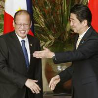 Abe rubs elbows with ASEAN chiefs