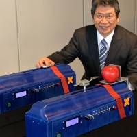 May the force be with you: Keio University professor Kouhei Ohnishi demonstrates his 'force transceiver' at his laboratory in Yokohama on Friday. | AFP-JIJI