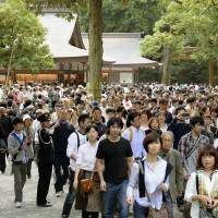 Moving party: Visitors crowd Ise Shrine in Mie Prefecture in October after its ritual relocation. | KYODO