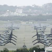 On the flight line: MV-22 Osprey aircraft sit on the tarmac at U.S. Marine Corps Air Station Futenma in Ginowan, Okinawa Prefecture, on Friday. | KYODO