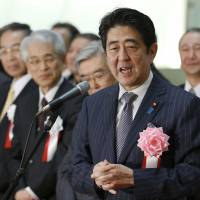 Market mover: Prime Minister Shinzo Abe speaks at a ceremony Monday to wrap up 2013 trading on the Tokyo Stock Exchange. | AP