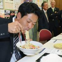 Local delicacy: A man slurps 'chanpon' noodles made of locally grown wheat during a recent promotion held in the city of Nagasaki. | KYODO