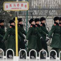 Hot spot: Chinese police guard the Japanese Embassy in Beijing on Friday. | KYODO
