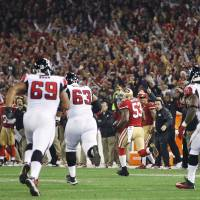 Off to the races: San Francisco linebacker NaVarro Bowman heads for the end zone on a 89-yard TD interception return against Atlanta in the fourth quarter on Monday night in the final regular-season game at Candlestick Park. The 49ers beat the Falcons 34-24. | AP