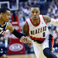 <B>Meet and compete: Blazers guard Damian Lillard drives against Jazz guard Trey Burke on Friday in <A HREF='http://Portland.AP' TARGET='_blank'>Portland.AP</A></B>