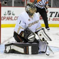 Try again later: Ducks goalie Jonas Hiller makes a save during a 3-2 overtime win over the Devils in New Jersey on Friday. | AP