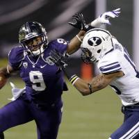 Want a piece of this? Washington's Damore'ea Stringfellow tries to shake BYU defensive back Michael Davis during the Fight Hunger Bowl on Friday in San Francisco. | AP