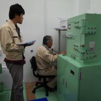 Under scrutiny: Researchers at the Marine Ecology Research Institute in Chiba Prefecture shows how radiation levels of fishery product samples are tested by germanium semiconductor detectors on Dec. 10.   KAZUAKI NAGATA