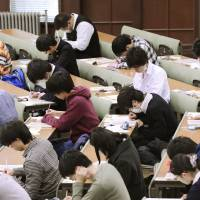 By the book: Applicants take the 'center' standardized exam at the University of Tokyo's Hongo campus in January. | KYODO